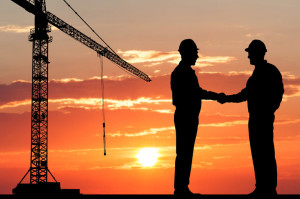41073872 - silhouette of two architect at construction site shaking hand